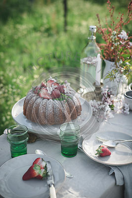 Lemon Coconut Bundt Cake with Strawberries on top