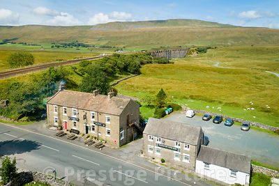 The Station Inn at Ribblehead with the famous viaduct in the distance