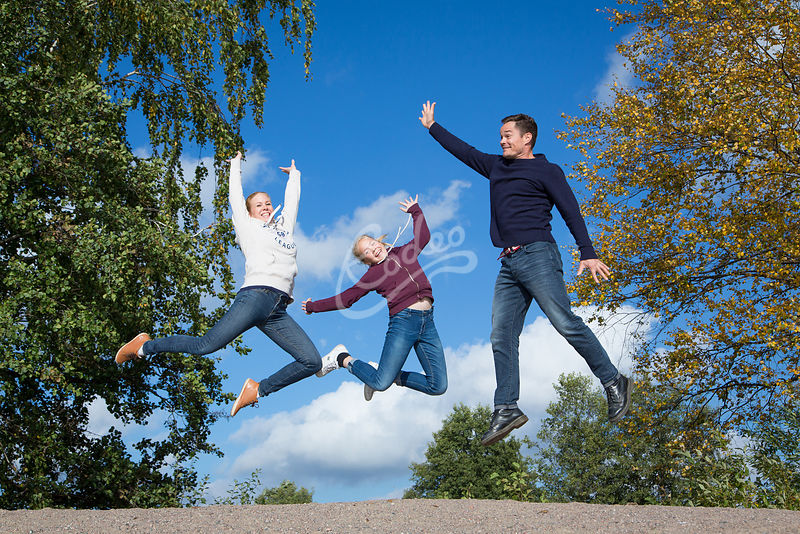 A family jumping together