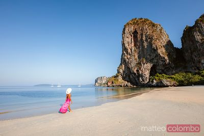 Woman with sarong hat at Phra Nang beach, Railay, Thailand