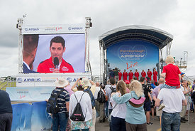 #120970,  Pilots from the RAF's Red Arrows display team being interviewed at the Farnborough Air Show, 2016.