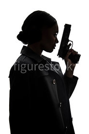 A silhouett of a tough woman, with a gun – shot from eye level.