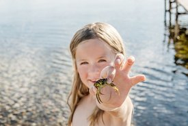 Danish girl holding crab
