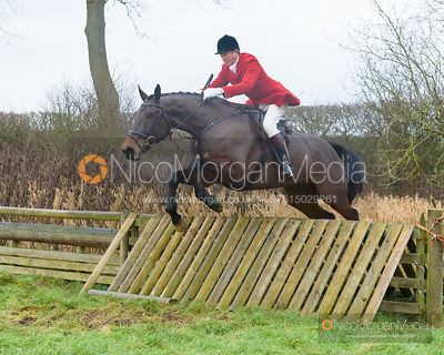 Nicholas Leeming jumping a hunt jump after the meet