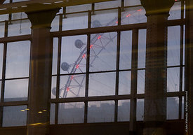 #62070  Old and new engineering.  The London Eye on the Southbank of the River Thames in London seen from Waterloo station at...