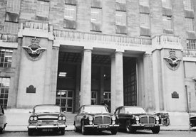 #124469,  Ministry of Defence building with departmental Rover cars at the ready, London, 1973.