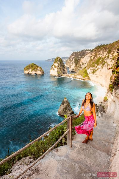 Beautiful woman at Diamond beach, Nusa Penida, Bali