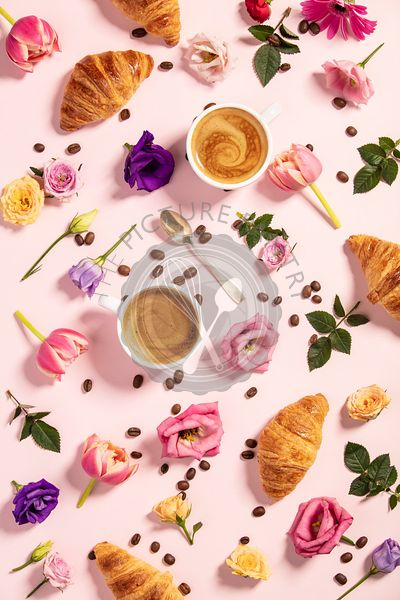 Morning coffee, croissants and a beautiful flowers . Flat lay