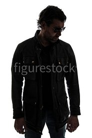 A silhouette of a mystery man, in sunglasses – shot from eye level.