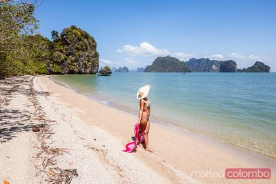 Woman with sarong relaxing on beach, Phang Nga bay, Thailand
