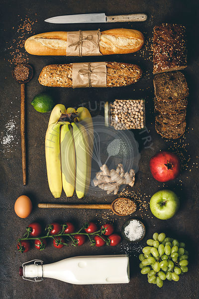 Flat lay of eco friendly grocery shopping -  milk, bread, fruits, vegetables, grains and legumes on rustic background