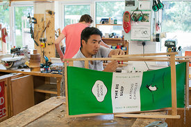 #73006,  Tomo Usuda and Tobe Beayens fixing a deckchair, carpentry workshop, Summerhill School, Leiston, Suffolk. The school ...