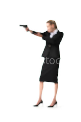 Silhouette of a blurred woman standing with a gun – shot from mid level.