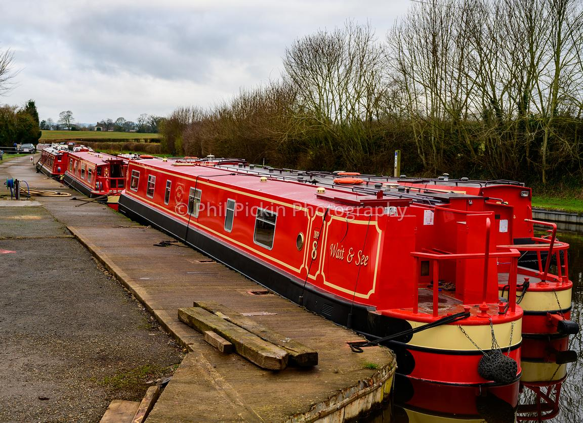 Red narrowboat Wait & See moored up at Whittington Wharf.