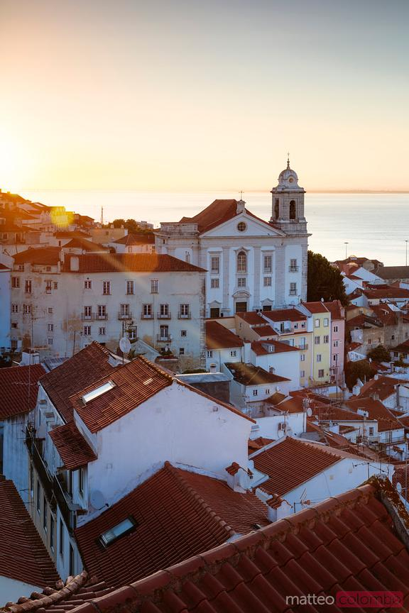 Sunrise over old town and sea, Lisbon, Portugal