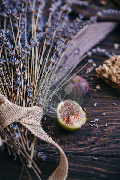 Fresh figs and lavender on rustic dark wooden table