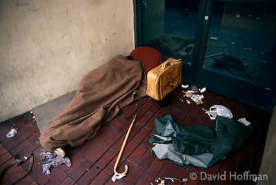 Disabled homeless man sleeping in a doorway in San Francisco, California, USA.