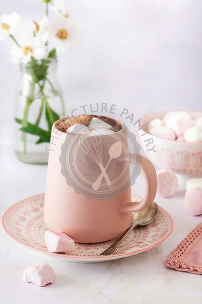 Hot chocolate with pink and white marshmallows.