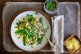 Pasta Primavera on stoneware plate  and linen place mat