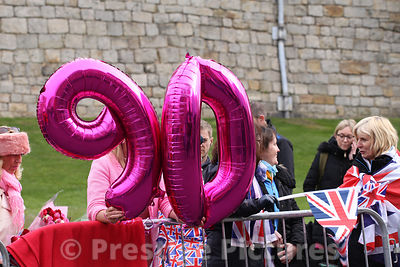 Two sisters from Cardiff Hold Ballons to present to The Queen