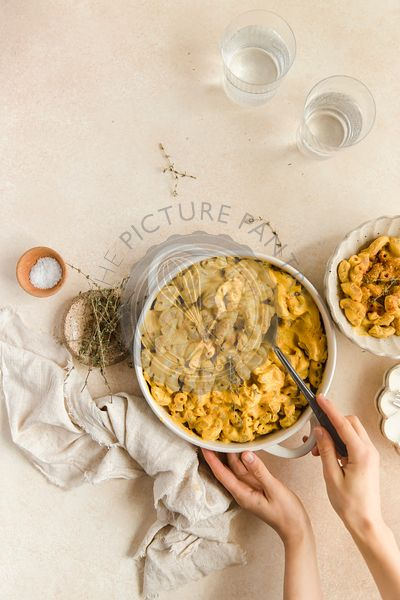 Mac n Cheese flat lay with hands