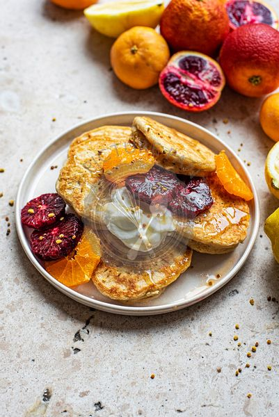 Lemon Pancakes with citrus fruits, including blood oranges and pomegranates