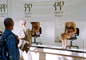 #024294  Live models used to promote Pretty Polly lingerie at Debenhams, Oxford St,