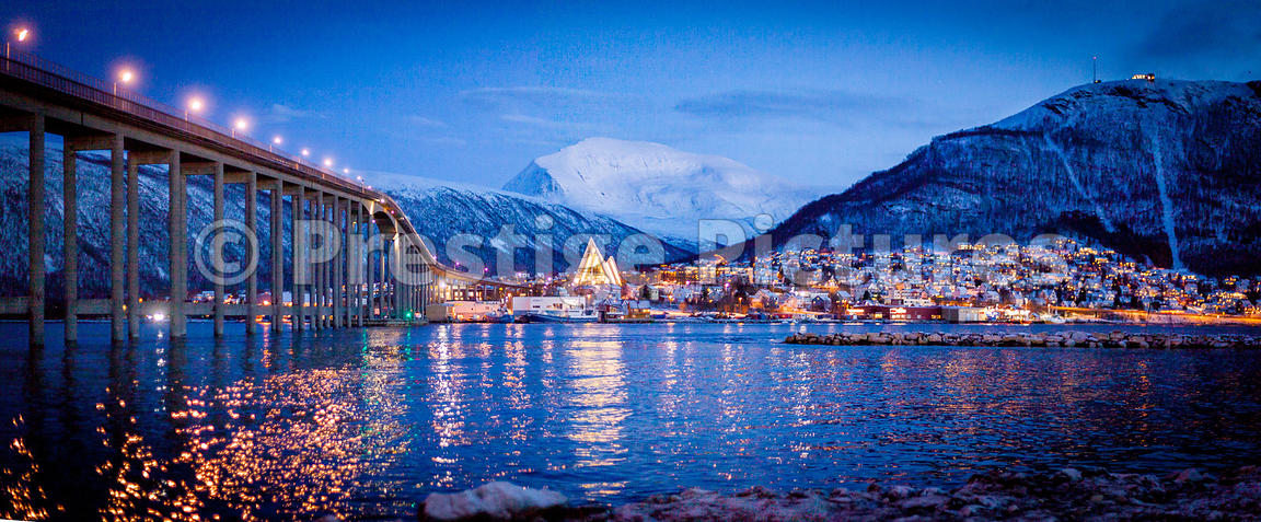 The Arctic Cathedral dominates the evening cityscape of Tromsø