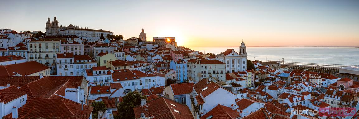 Panoramic sunrise over Alfama district, Lisbon, Portugal