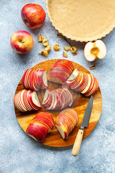 Preparation of an apple tart.Sliced apples on a wooden board