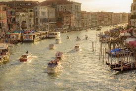 VENICE, ITALY - OCTOBER 25, 2017: Water Taxis and vaporetto on the grand canal close to the Rialto Bridge in Venice.
