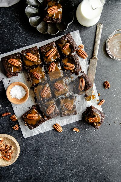 Turtle Brownies with salted caramel and pecan topping in a flatlay.