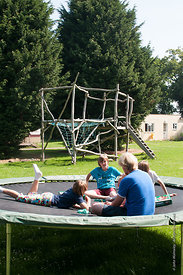 "#73097,  Philipp Klaus, holding an English class on the trampoline using the ""Upwords"" game, Summerhill School, Leiston, Suff..."