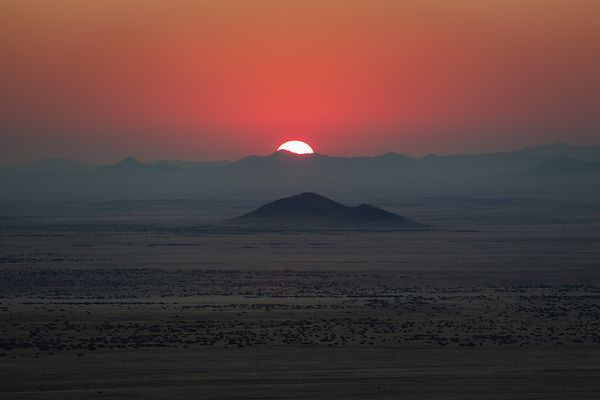 Lookout over Namib Desert at sunset from God's Window, southern Namibia near Aus.
