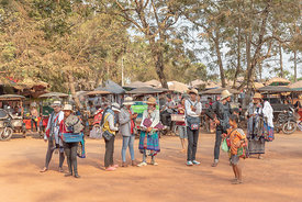 SIEM REAP, CAMBODIA - FEBRUARY 10, 2019: People selling craftwork and tourists items in the car park outside Ta Phrom temple ...
