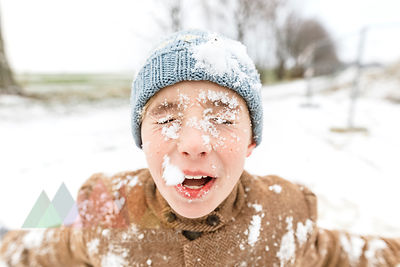 Portrait of boy with snow in his face
