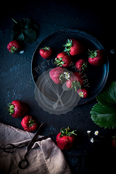 Strawberries and Daisies On A Dark Plate
