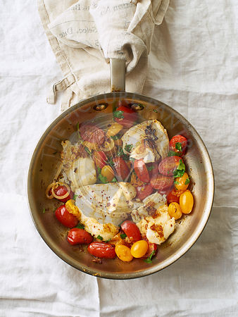 Roasted white fish with cherry tomatoes