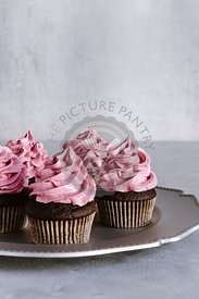 Chocolate cupcakes with black currant marshmallow frosting.