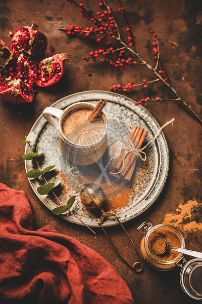 Turkish traditional wintertime hot drink Salep in mug with cinnamon