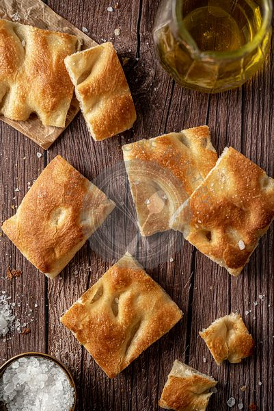 Sliced focaccia bread with salt and olive oil