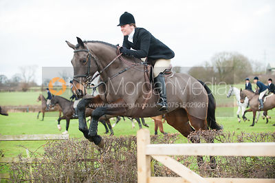 Chloe Newton jumping a hedge