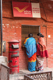 VARANASI, INDIA - FEBRUARY 11, 2015: Two Indian women a at India Post office in Varanasi, India.