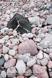 Image - Stones and pebbles on beach with black boulder