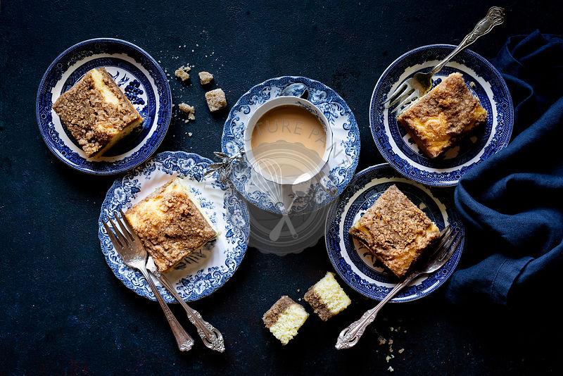 Gluten-free Coffee Cake with Coffee against a dark blue background