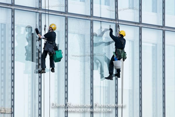 Image - Two window cleaners hanging on ropes