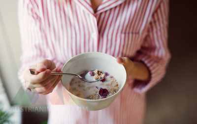 Close-up of woman holding cereal bowl