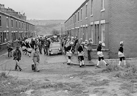 #77114,  The 'Nutters' Dance', Bacup, Lancashire,  1973.  On Easter Saturday every year the 'Coconut Dancers' gather at one b...
