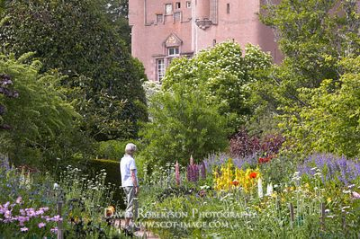Image - Woman enjoying the June Border, Crathes Castle, Aberdeenshire, Scotland