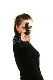 A tough woman, pointing a gun – shot from eye level.